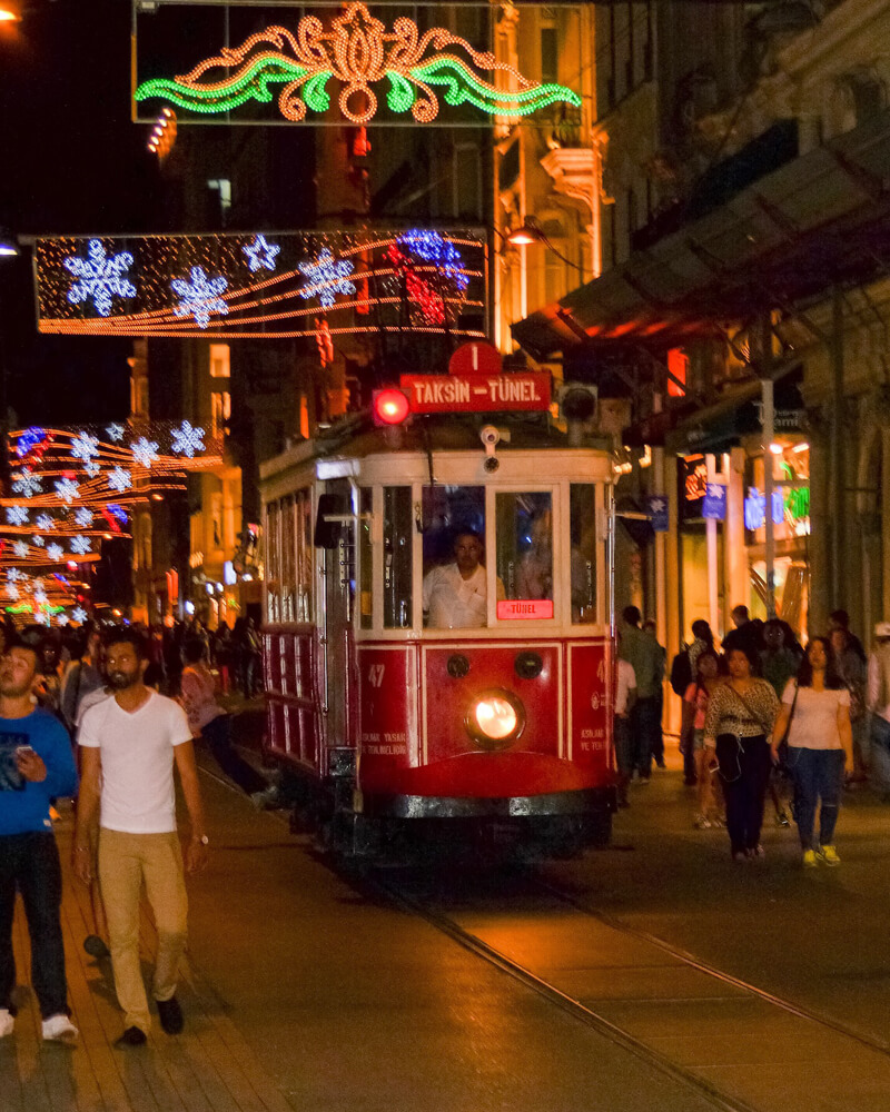 Taksim tram on Istiklal street. The city of Istanbul comes alive in the evening. Explore on a walking tour.