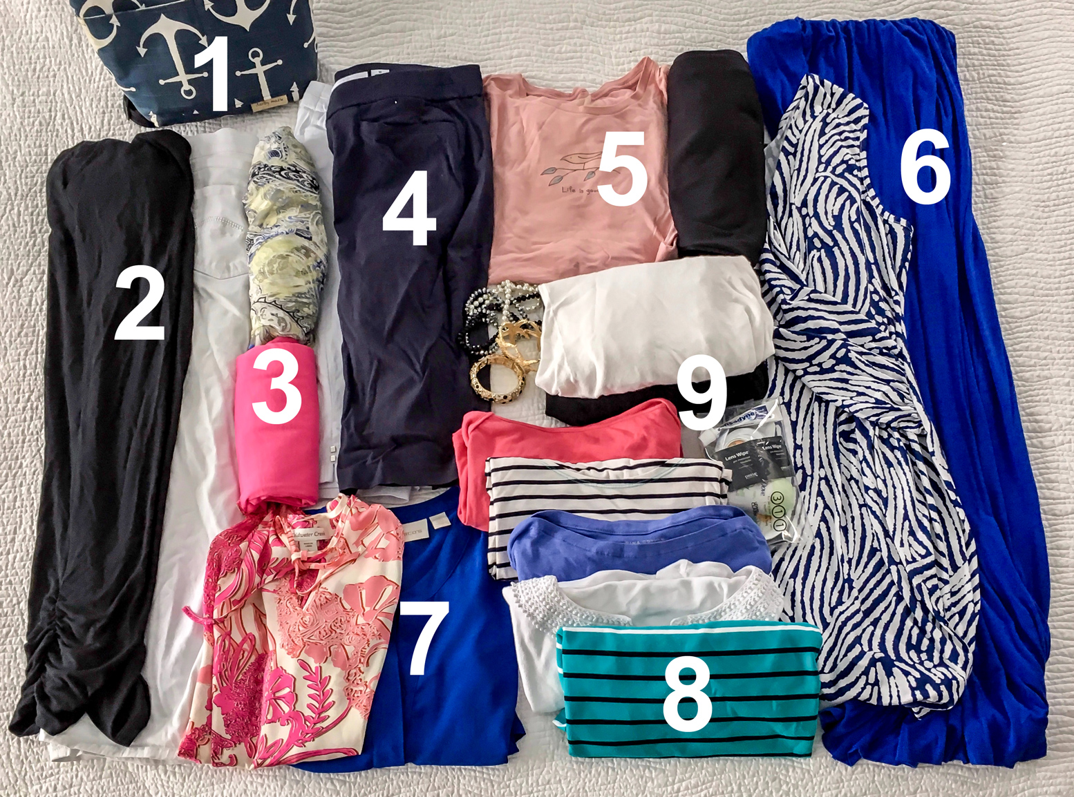 What I Packed for a Mediterranean Cruise - flatlay of travel clothing for a luxury cruise vacation