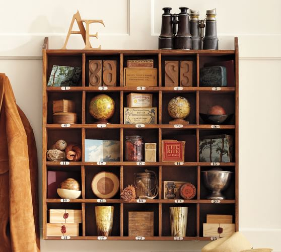 Display travel souvenirs in a Cubby Organizer by Pottery Barn