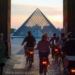 Maintain fitness while traveling by taking an active tour. Biking in Paris.