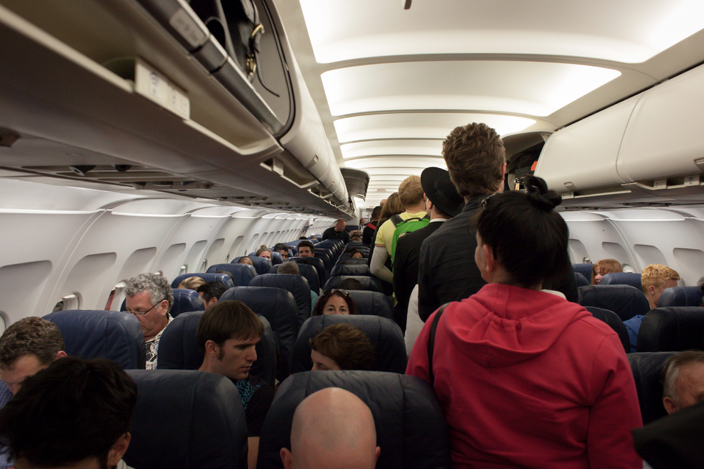 interior plane image - airplane travel increases the chance of germ transmission. Tips to stay healthy while traveling
