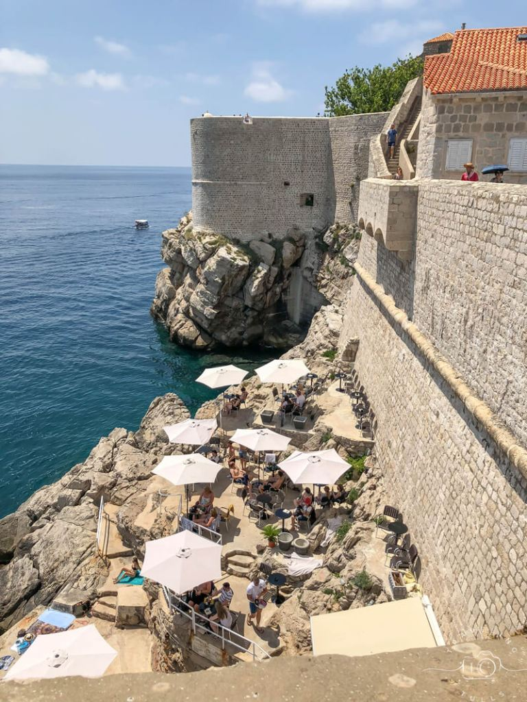 Dubrovnik, view of cafe on the walls of the city. Book a private shore excursion to see the landmarks in the morning and enjoy a quiet drink in the afternoon