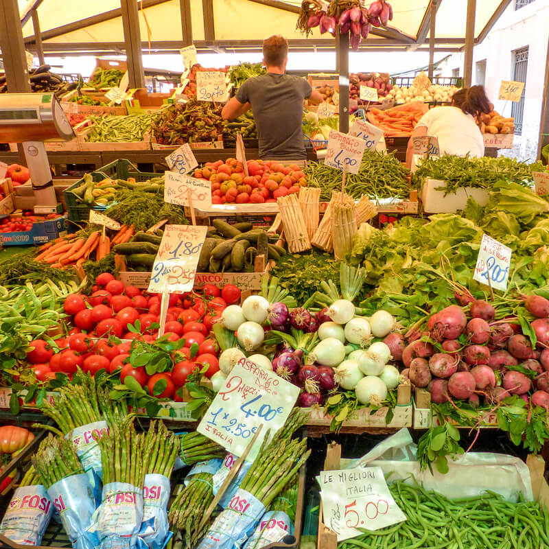 Visit the Rialto market early in the day to enjoy a less touristy view of Venice.