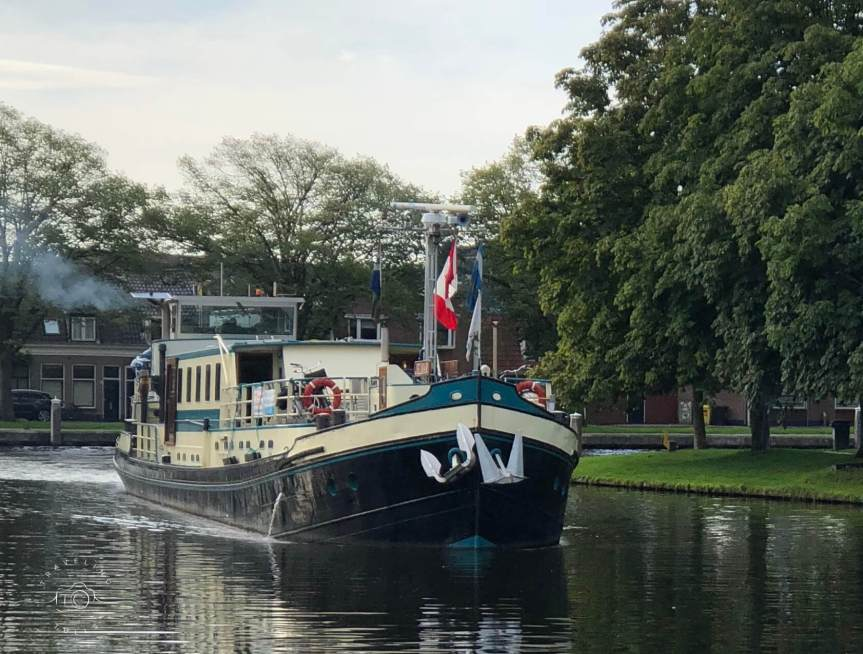 Our barge, the Jelmar, leaving town for the next stop on our bike and barge Holland tour.