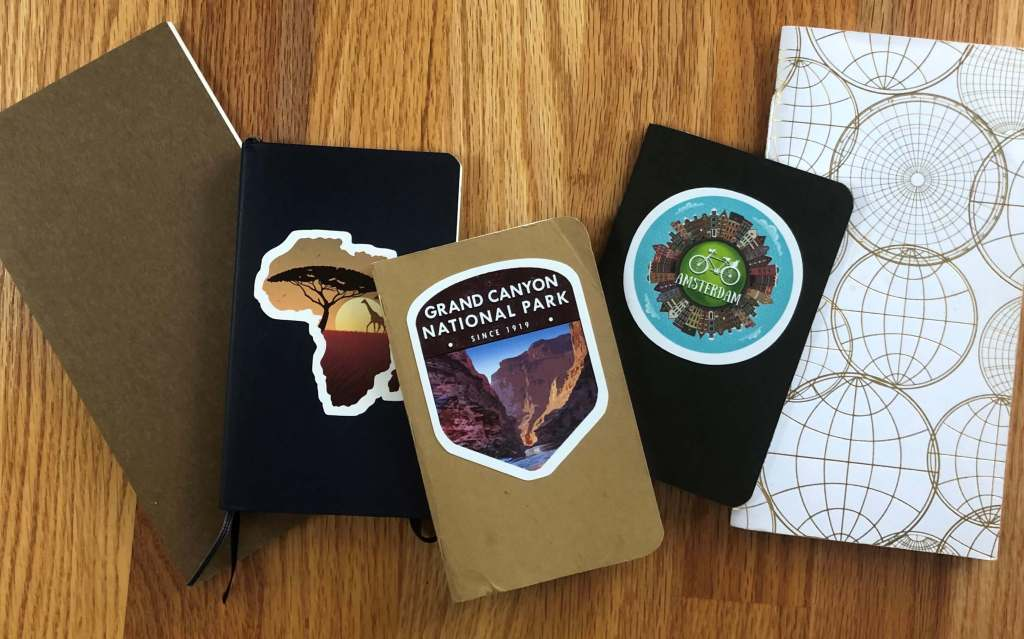 Image of travel journals in different sizes.