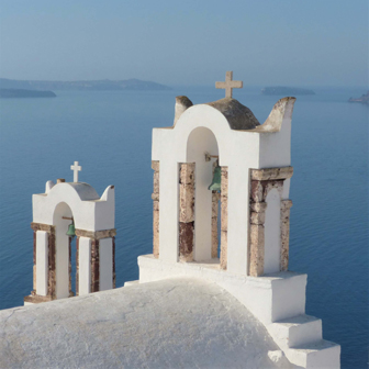 white church against blue Mediterranean in Santorini