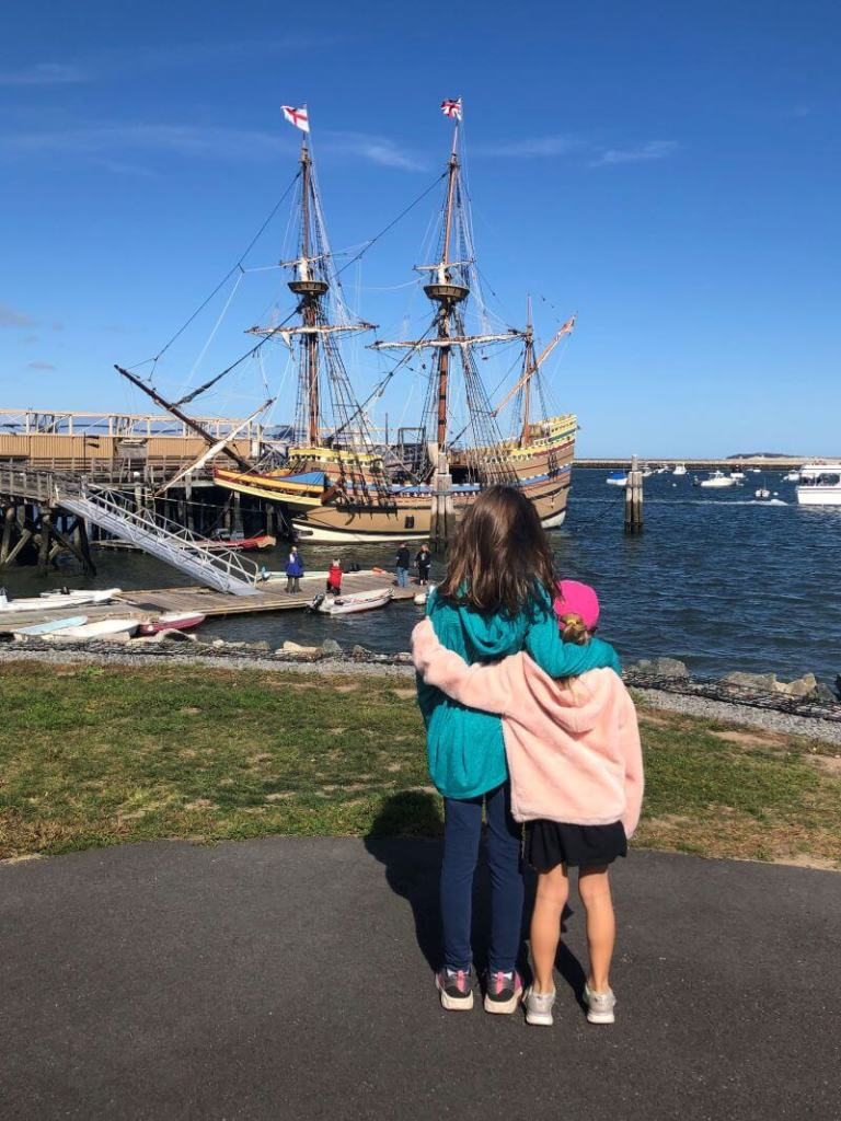 children in front of the Mayflower 2 in Plymouth Harbor