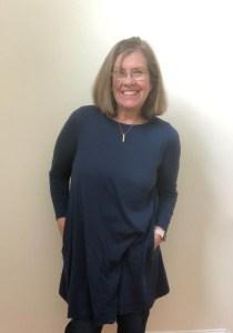 Travel dress - woman over 60 wearing a merino wool dress.