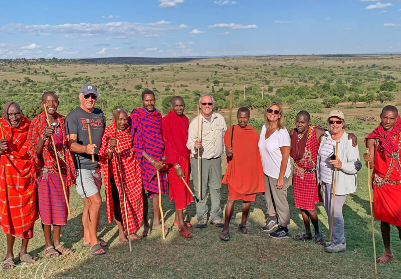 Maasai warriors in Kenya posing with Amy, Dave, and friends.